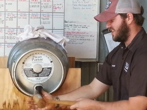 Hugh trys to get that firkin barrel open.