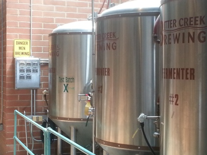 The sign next to the tanks at Bitter Creek Brewing make it very clear that important work is being done.